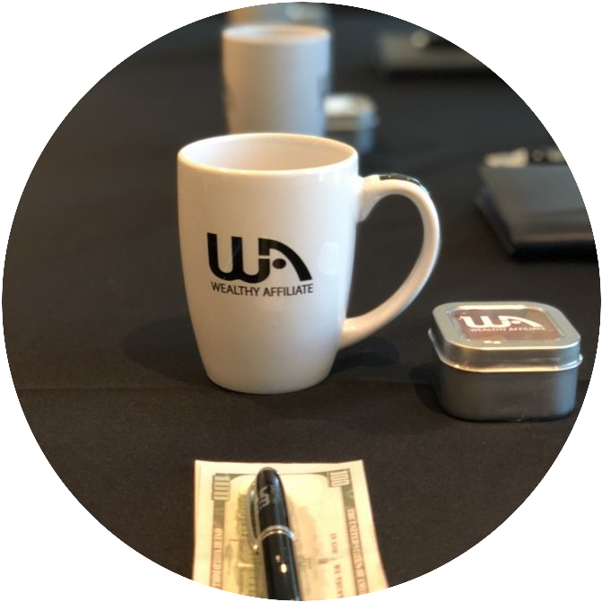 Wealthy Affiliate accoutrements used at Vegas Conference such as cheques, cups
